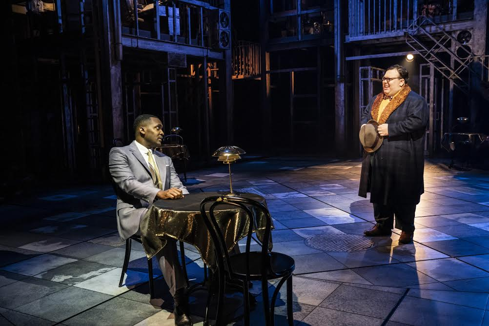 Kadiff Kirwan and TJ Lloyd in Guys and Dolls. Design, Janet Bird; lighting design, Howard Hudson. Photo: Johan Persson.