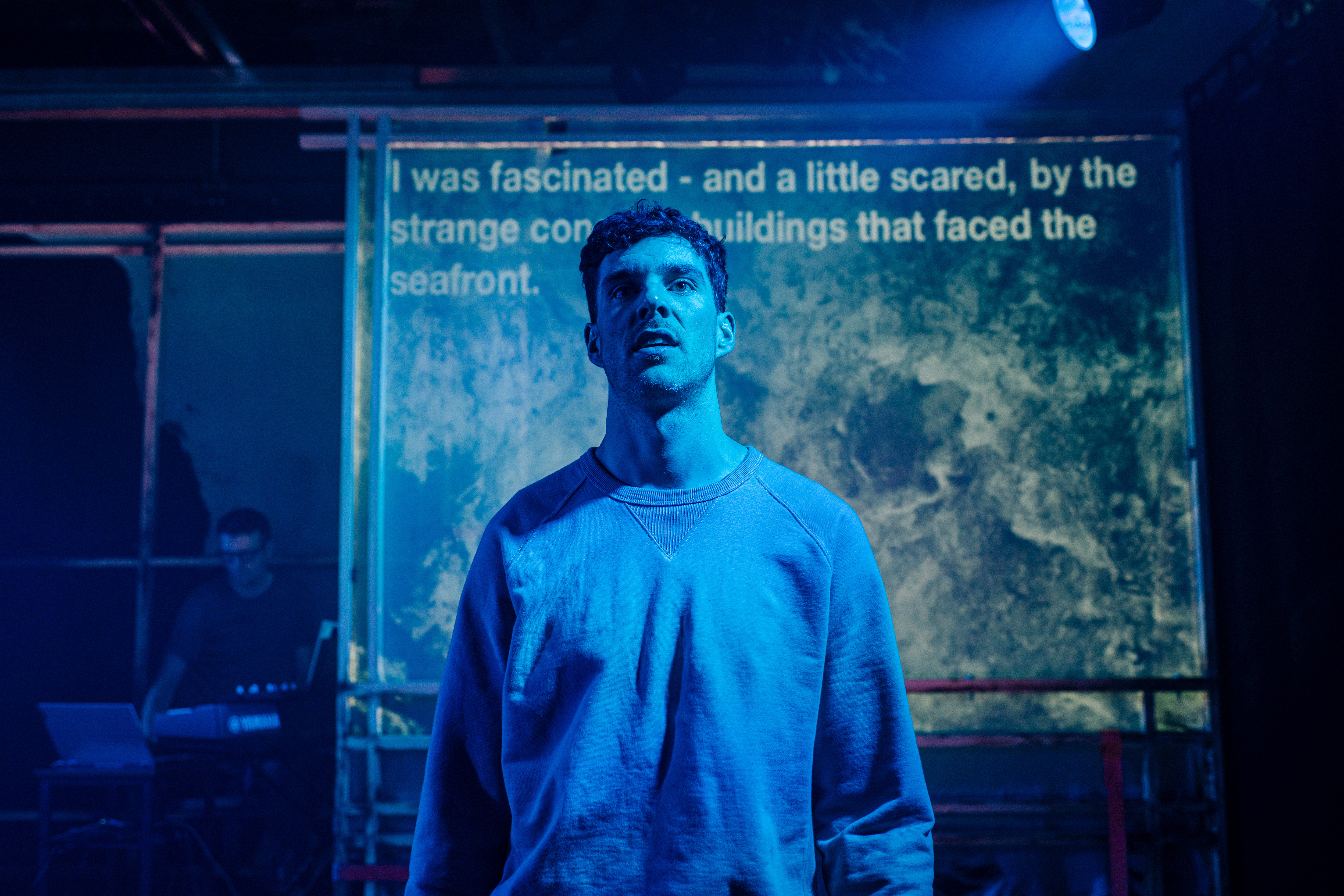 Alasdair C. Whyte in MAIM  at Tron Theatre, Glasgow. Design, Kenneth MacLeòid; lighting design, Benny Goodman; video design, Lewis Den Hertog. Photo: Mihaela Bodlovic.