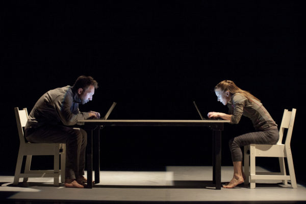 Jan Patzke and Olivia Quayle demonstrate your posture when reading this review of Imbalance at the London International Mime Festival. Photo: Moving Productions.