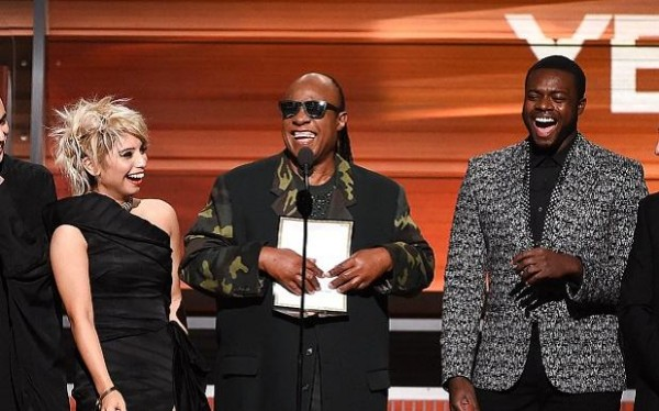 "Stevie Wonder reads the winner of the 2016 Grammy for ""Song of the Year"" in braille"