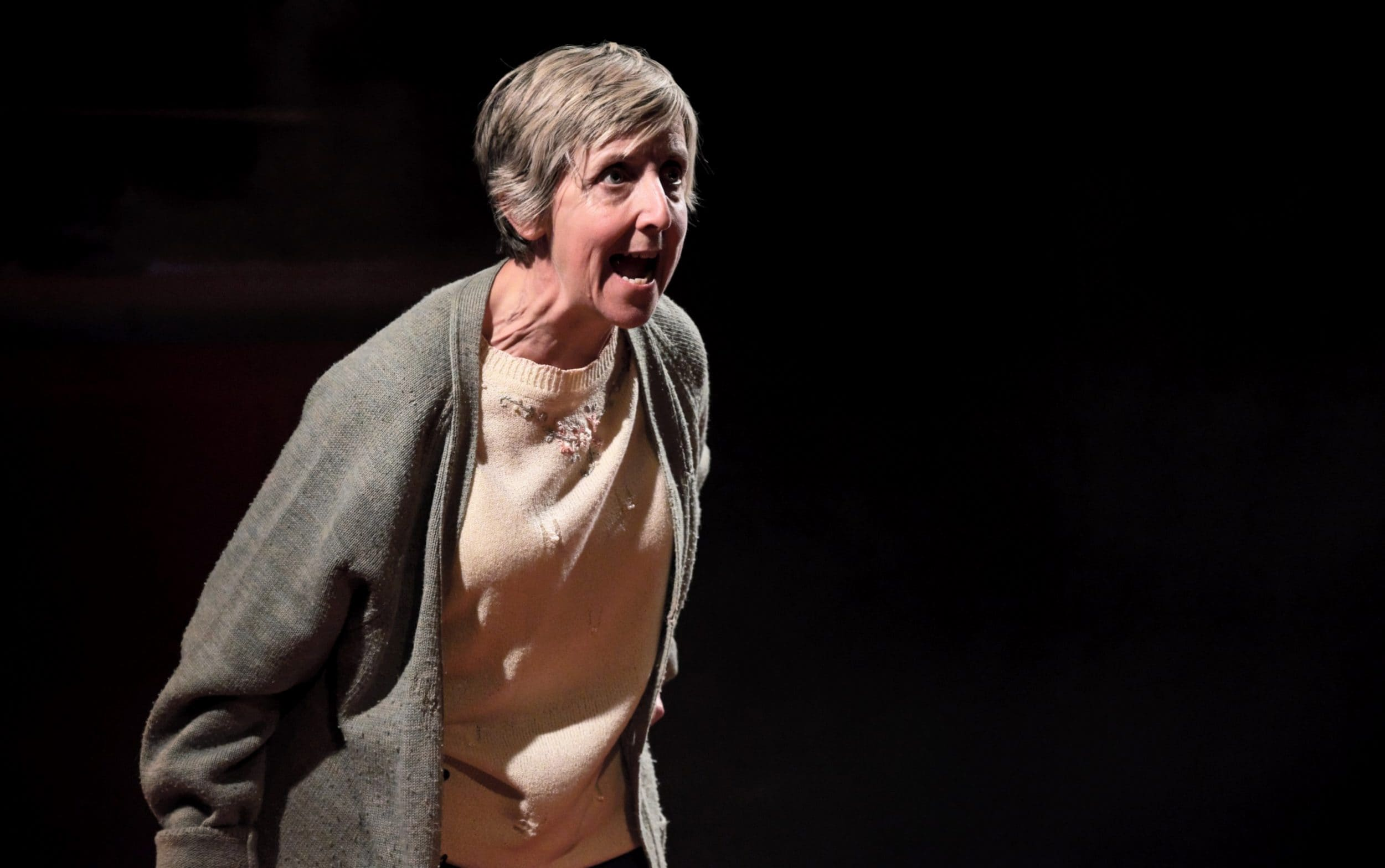 Julie Hesmondhalgh in There Are No Beginnings at Leeds Playhouse. Design, Camilla Clarke; lighting design, Amy Mae. Photo: Zoe Martin.