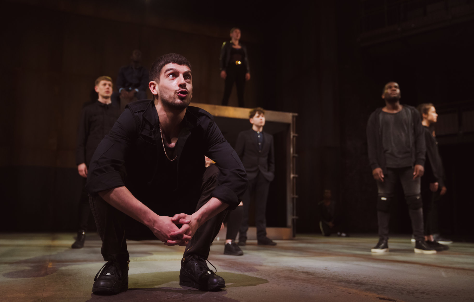Nima Taleghani and company in Romeo and Juliet at Theatre Royal Norwich. Design, Tom Piper; lighting design, Charles Balfour. Photo: Topher McGrillis.