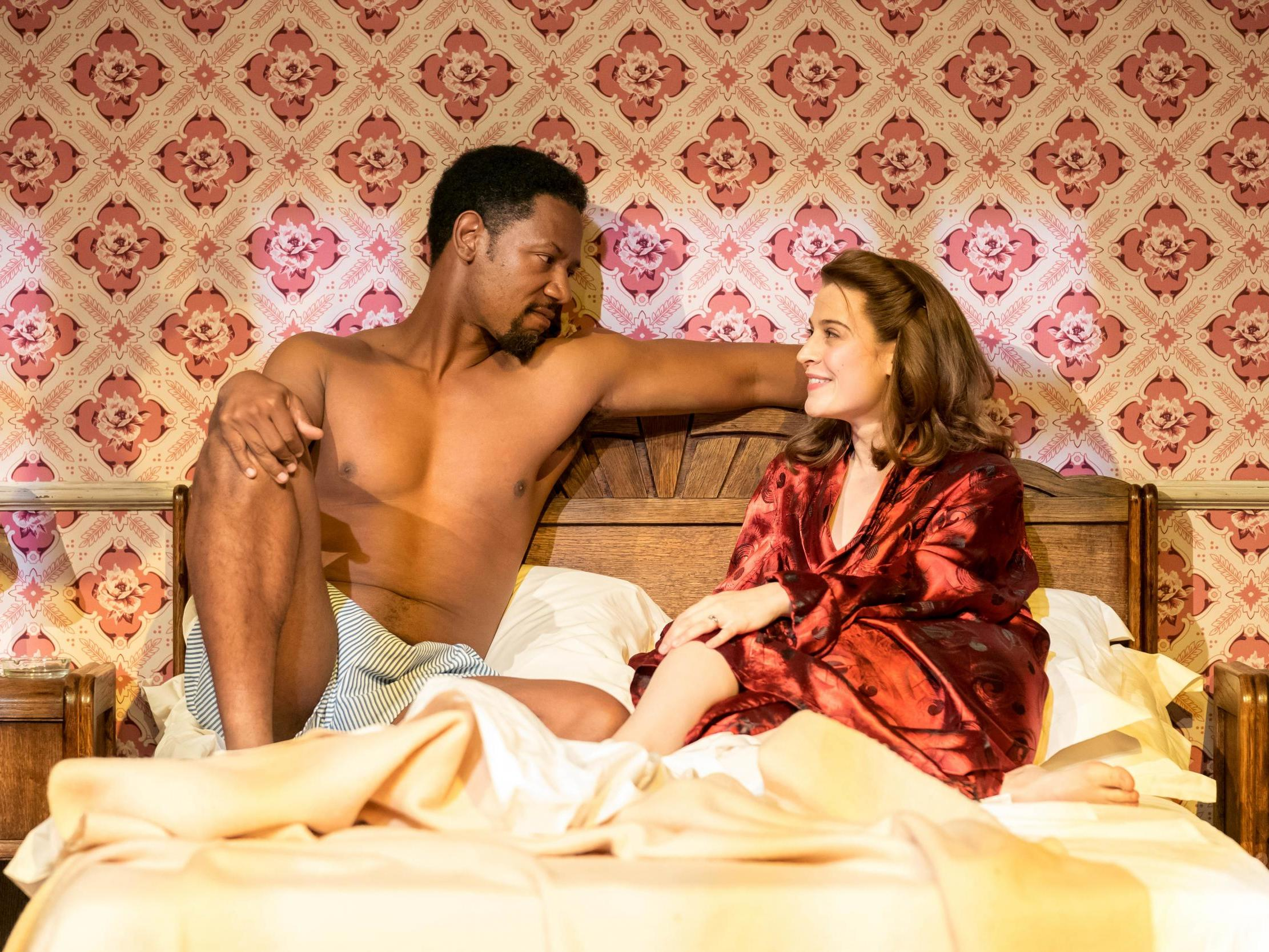 Tory Kittles and Emma Paetz in 8 Hotels at Chichester Festival Theatre. Design, Rob Howell; lighting design, Peter Mumford. Photo: Manuel Harlan.